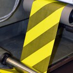 Custom safety tape being printed.