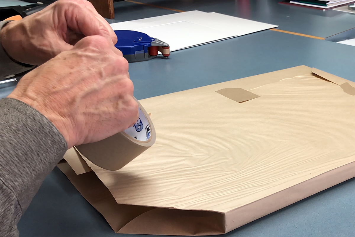 Pro® 183 Kraft Tape being used to the wrap a our finished framed piece.