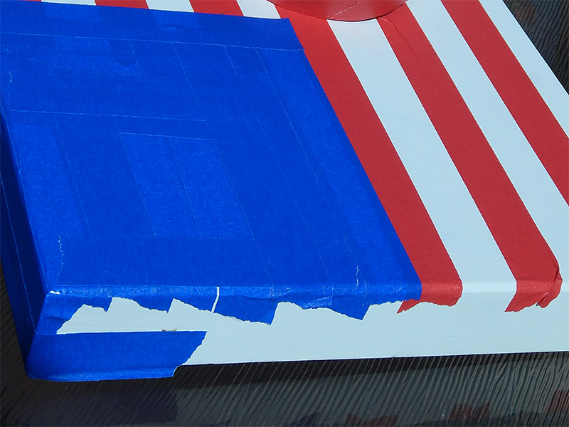 Use the Pro® 46 Colored Crepe Masking Tape in Blue to create the blue corner of your flag.