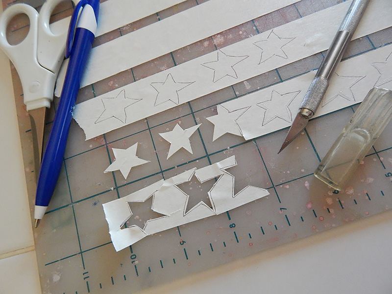 Use exacto blade to score the inside of each star shape.