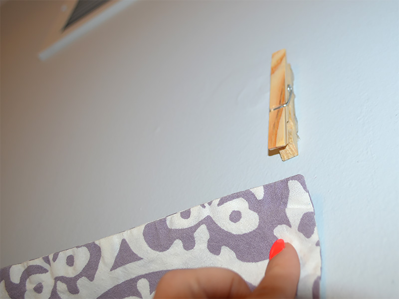 Remove liner and place UGlu® side of clothes pins to wall