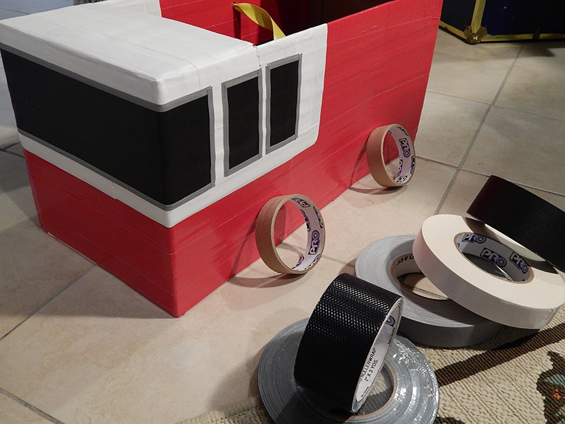 Let's get rolling and add some wheels! Sticking to the tape theme, I was able to recycle my one inch Pro® cores here.