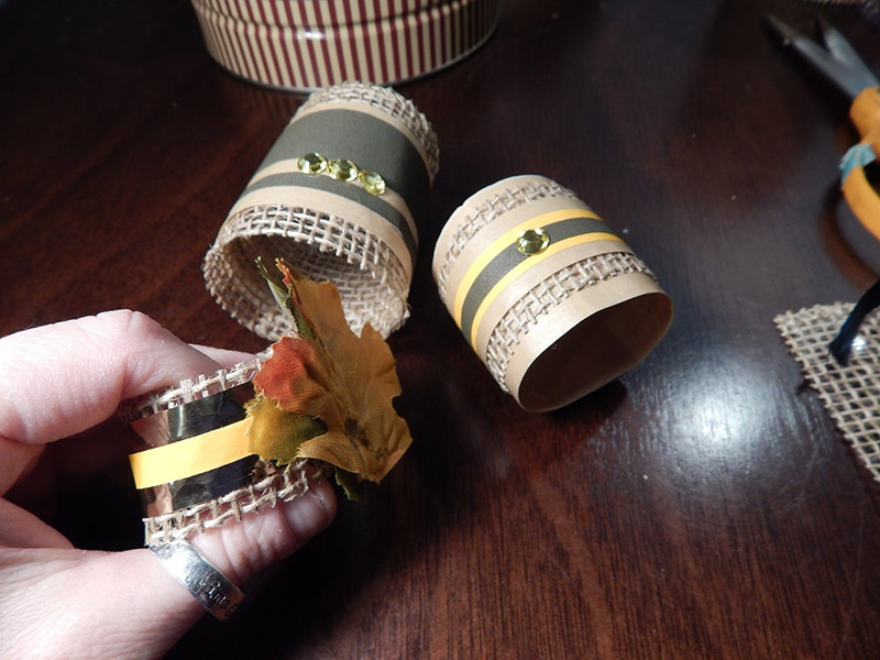 I even wrap the burlap around my napkins and made some napkin rings to match. Then I just added embellishments like Pro® Sheen strips and rhinestones from my local craft store.