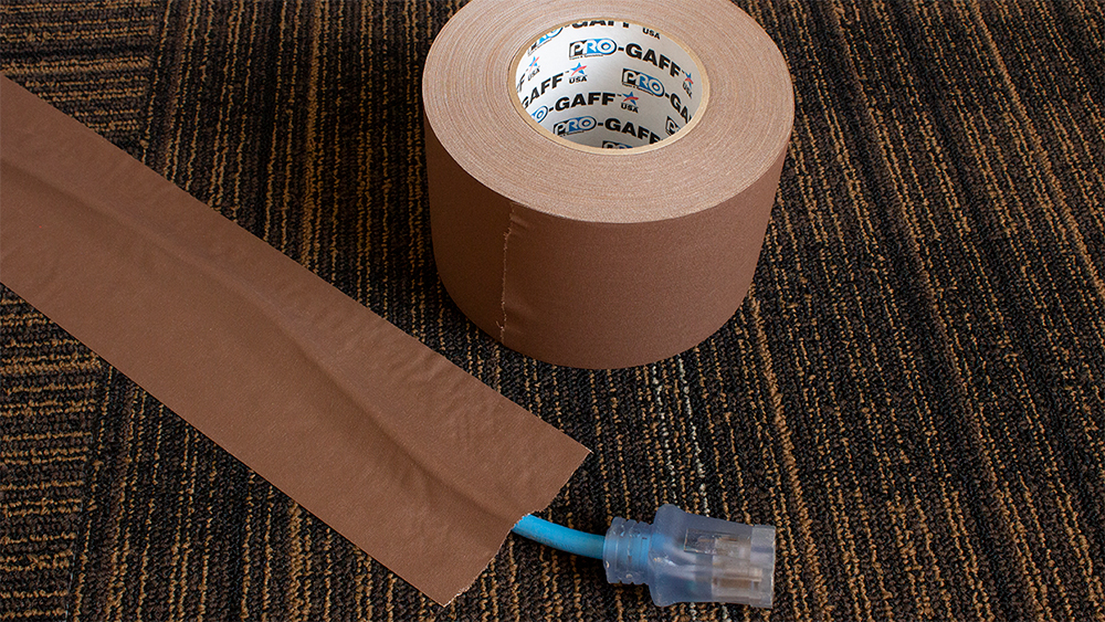 For cable hold down: Pro Gaff® is a premium matte cloth tape available in 19 designer colors that can work into any Tradeshow Exhibit.