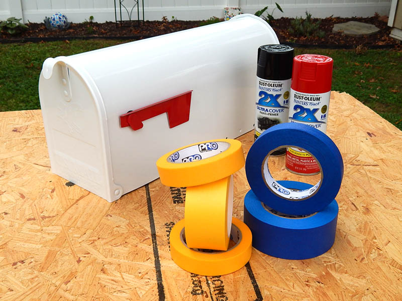 Spray paint and tape, ready to decorate the Barn mailbox