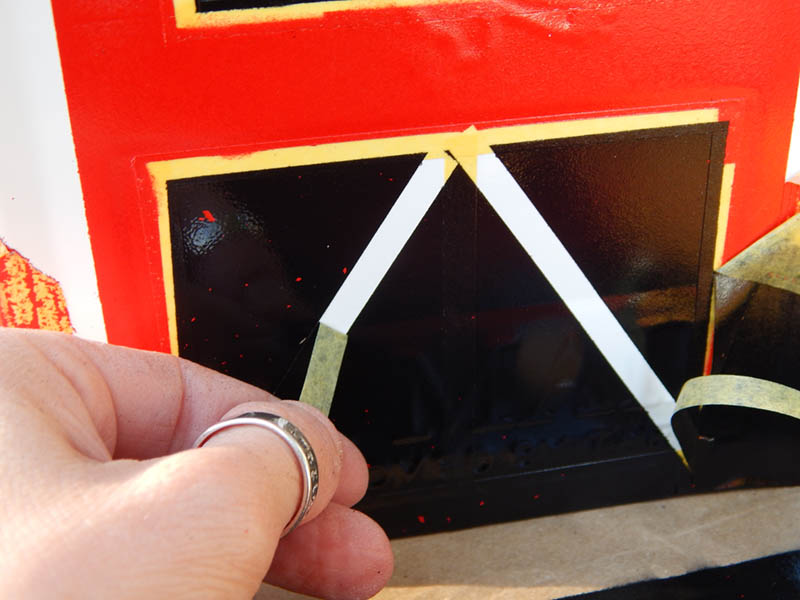 Peeling the masking tape off - look how sharp the edges are!