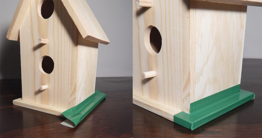 Beginning to tape down the Pro Duct 120 in Green to the Birdhouse