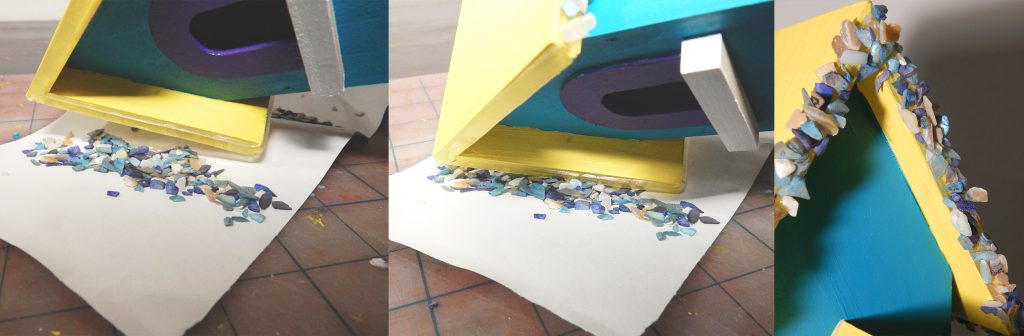 After I've put down the EHB tape, I can stick on the rocks and other embellishments to the birdhouse
