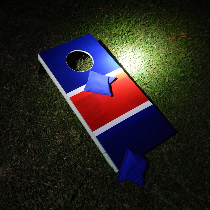 The cornhole game board in the dark... see what happens when we turn the light off!