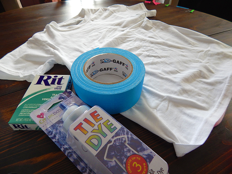 A white tshirt, Pro Gaff® tape, and Rit fabric dye, all ready for our tie-dye tshirt project!