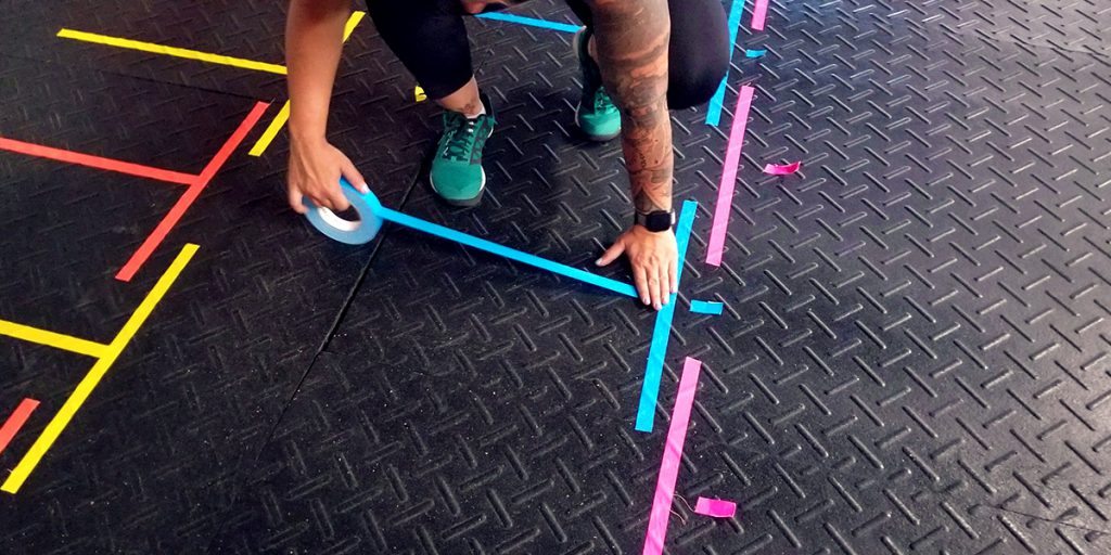 Putting Pro Gaff® tape down on the gym floor