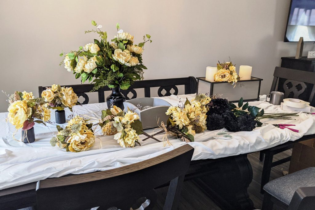 Placing a tablecloth on your work table or area will make clean up easier when you're done with your faux floral arrangements