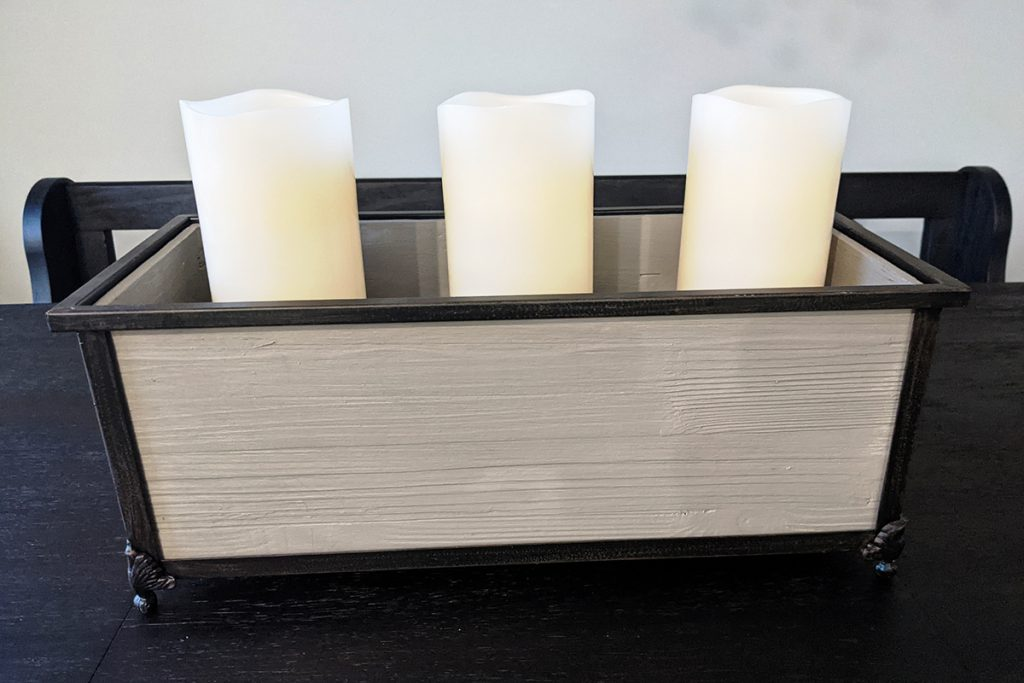 Place your candles into the bases for the faux floral arrangement