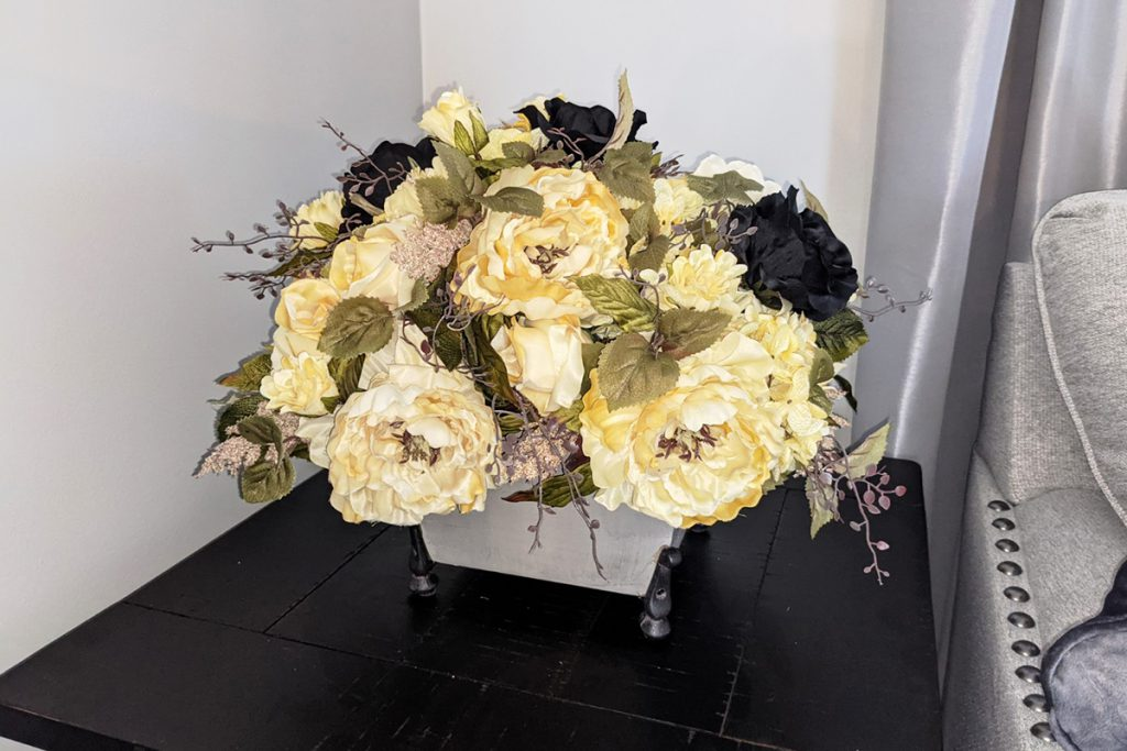 The finished faux floral arrangement in the square base