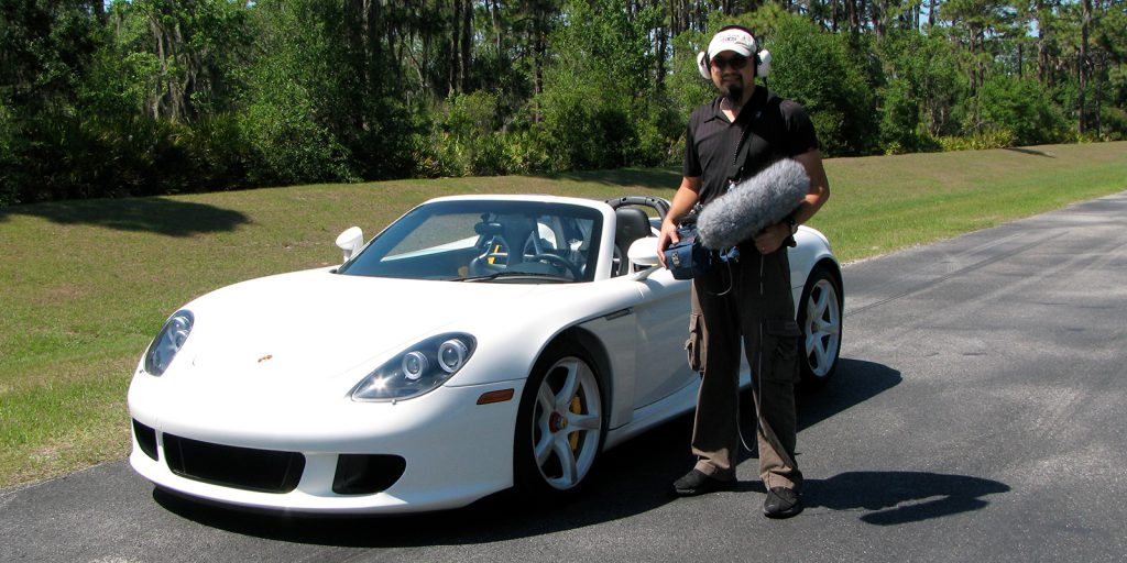 Watson Wu ready to record sound from a Porsche Carerra GT for Transformers