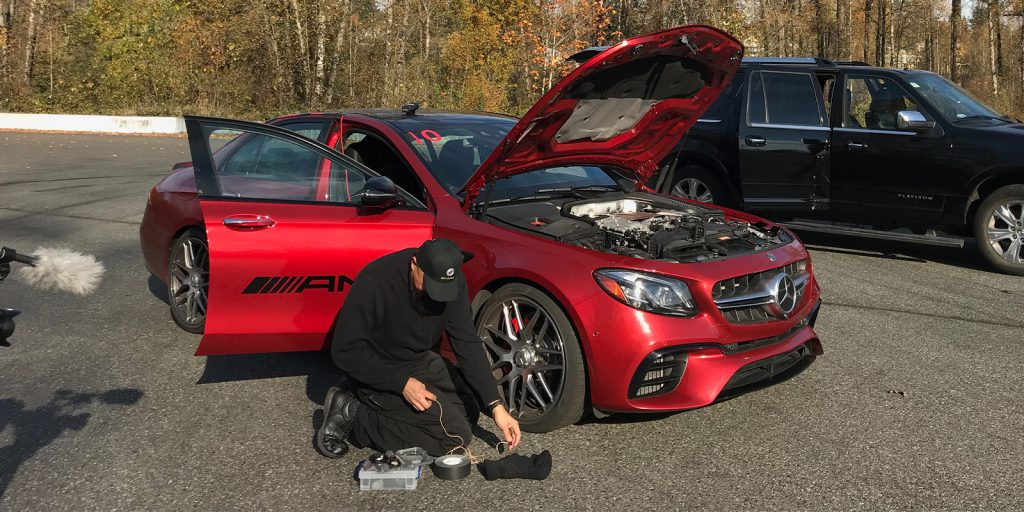 Watson Wu rigging microphones to a Mercedes-AMG e63S car using Pro Gaff® tape