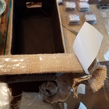 UGlu<sup>®</sup> being used instead of hot glue to decorate a burlap box
